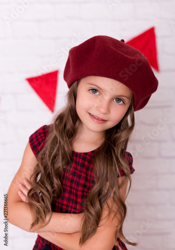 29791b7ca10 Portrait of little girl wearing a beret hat.