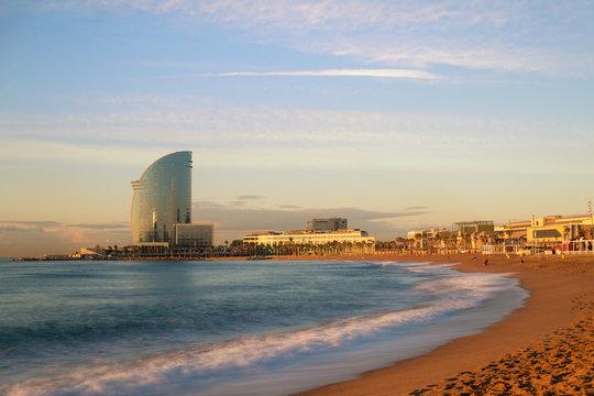 Barceloneta Beach in Barcelona with colorful sky at sunrise. Seafront, beach,coast in Spain. Suburb of Barcelona, Catalonia