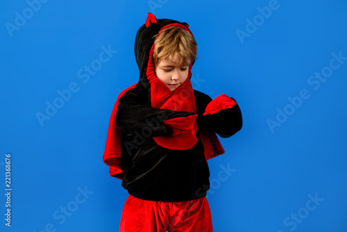 ac36d879111eb Halloween concept. Kid in monster halloween costume. Trick or ...