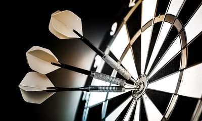 Dartboard with arrows on ackground