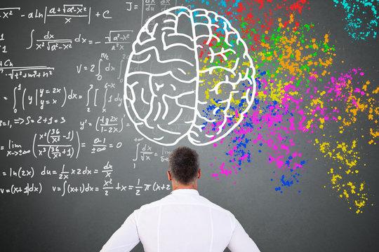 Man Looking At Left Right Brain Diagram