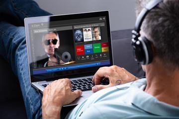 Man Watching Movie On Laptop