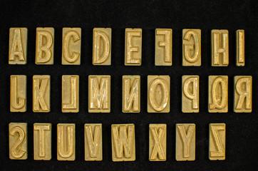 Vintage brass typeset letterpress alphabet letters reversed