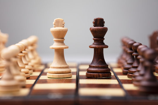 Wooden Chess Pieces On Board Game
