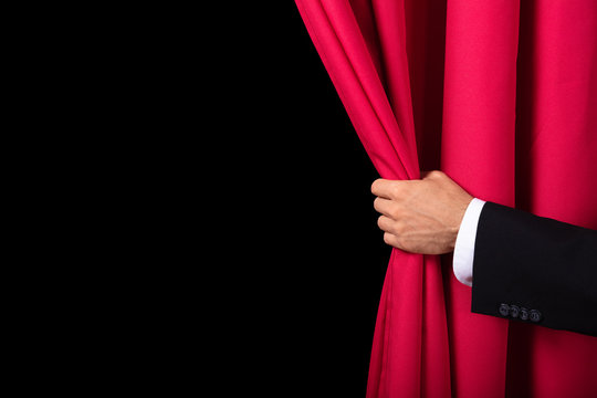 Two Men Opening Red Curtain