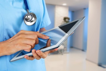 Close-up Doctor at hospital working with tablet pc