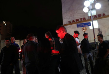 Supporters of presidential candidate Jair Bolsonaro are pictured outside the Santa Casa hospital where he was hospitalized after being stabbed in Juiz de Fora