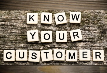 Know your customer with wooden cubes on background