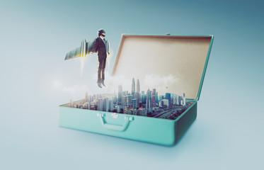 Businessman wear a rocket suit lift out from open retro vintage suitcase  . Business success concept .