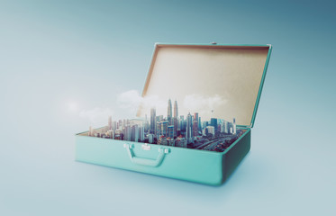 Modern city skyline in an open retro vintage suitcase isolated on light blue background .