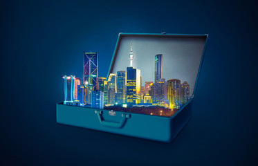 Night scene modern city skyscraper in an open retro vintage suitcase isolated on blue background .