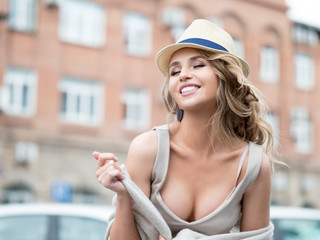 Young beautiful woman walking the streets of an Italian town.