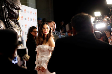 Actor Olivia Munn poses at the premiere of The Predator during the Toronto International Film Festival (TIFF) in Toronto