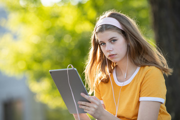 Young girl student with tablet