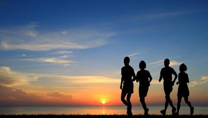 silhouette lover couple running on sunrise