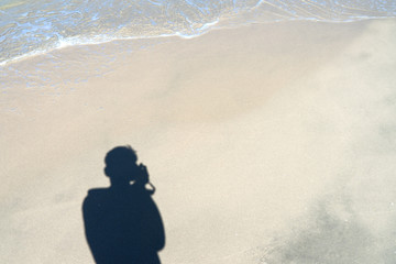 Men's shadow on the sand