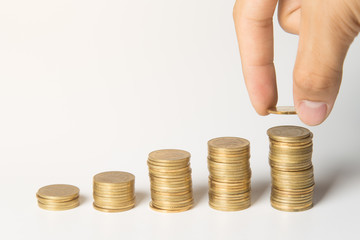 Hand putting coins on stack, Saving money and business concept.