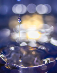 A small water drop fall on water surface and the splash jump to form a good clear, beautiful shape.