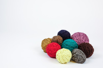 Colorful balls of yarn. Knitting wool threads. White background. Blank copy space for text.