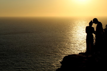 Sunset silhouettes during amazing golden sunset in Ibiza