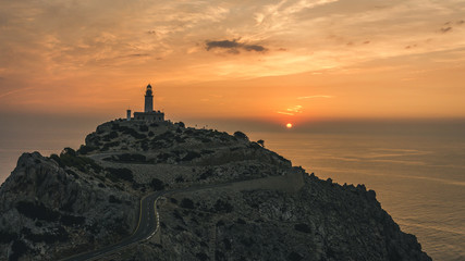 Very photographed place and tourist attraction is Cap de Formentor lighthouse on the north eastern tip of the Serra de Tramuntan mountain range in Majorca at sunrise. Romantic morning at sea.