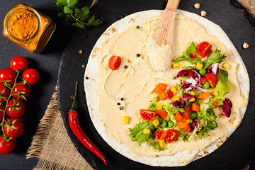 Tortilla with vegetables and hummus with chickpeas