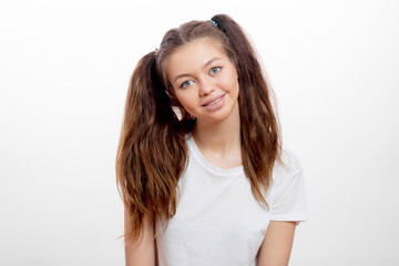charming adorable childish woman with big blue eyes wearing two ponytails and looking at the camera. isolated white background. youth, people concept