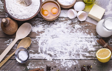 Natural organic ingredients for baking homemade biscuit on a wooden table. Flat lay.