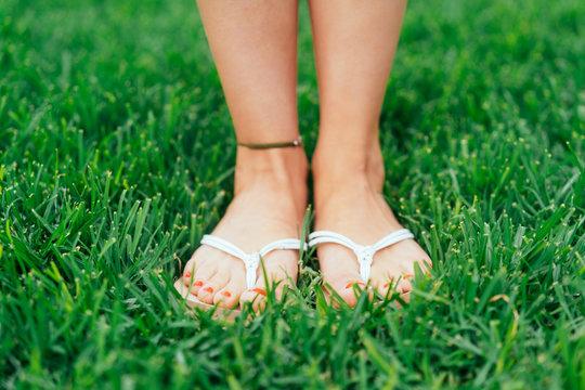 Feet of a woman wearing summer sandals