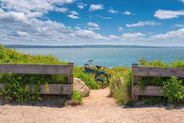Bike left on Cape Cod beach trail , Massachusetts.
