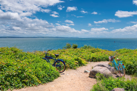 Two bicycles on the beach trail at sunny summer day in Cape Cod beach, Massachusetts.