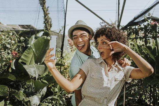 Friends taking a selfie at a garden