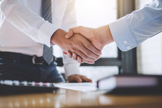 Business team greeting and finishing up a meeting, Two Business handshake of collaboration after discussing in team good deal of Trading contract for both companies, Finance, accounting, investment
