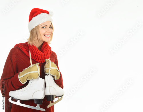 8e20171822a Ice skating woman. Girl in winter with ice skates. Beautiful woman in  winter clothes