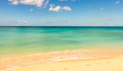 Peaceful seascape, paradise beach with clear and colorful water and clean sand in Barbados.
