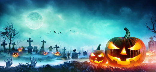 Wall Mural - Jack O Lanterns And Zombie Hands Rising Out Of A Graveyard In Misty Night