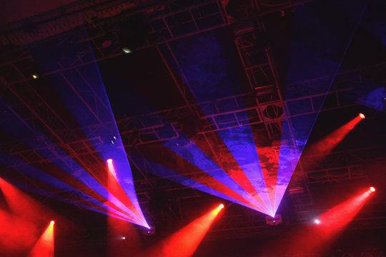 Laser lights illuminating music venue