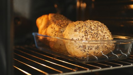 Image with Fresh Bread Cooked in Oven in Home Kitchen
