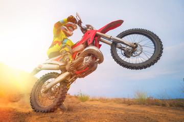 Motocross rider doing a wheelie Fototapete