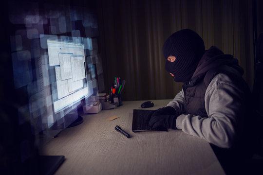 Computer hacker stealing data from a computer