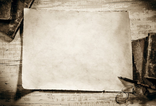 old parchment on antique writing desk,sepia image
