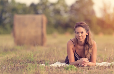 Vintage photo of a beautiful woman in the meadow