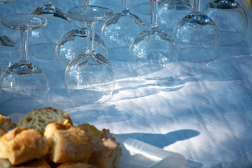 Table served outside in garden with many empty wine glasses for party, celebration or wine tasting