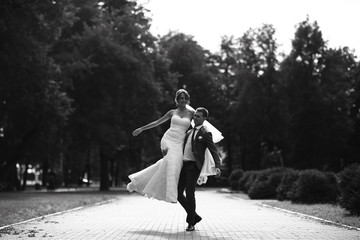 Wedding dance in the park of young bride and groom