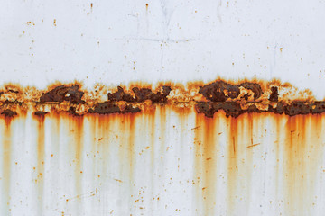 Corrosion of welding seam with red stains on a old white metal sheet. Abstract background Wall mural