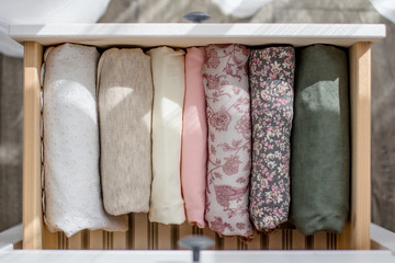 ladies' clothing of the pastel colors in the cabinet drawer