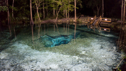 Nigth photo of the surface of the water od the Devils ear cavern in Ginnie Springs