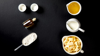 Ingredients for Baking Cake, Pie, Cake or Muffin. Preparation of the test on a black background.Top View.Copy space for Text.selective focus.