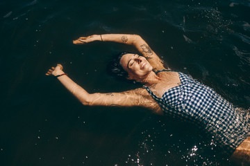 Woman relaxing by floating in water