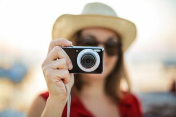 Girl shooting a souvenir photo